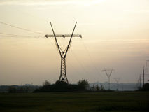 High voltage power lines at sunset Stock Photo