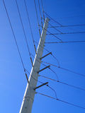 High Voltage Power Lines run through a large metal Utility pole Stock Photos
