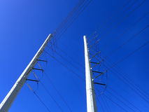 High Voltage Power Lines run through a large metal Utility pole Royalty Free Stock Photography