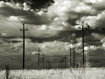 High-voltage power lines in the steppe. Infrared. Stock Images
