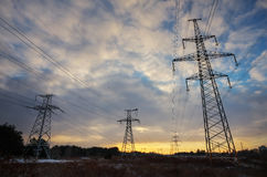 High-voltage power lines during sunrise Royalty Free Stock Photography