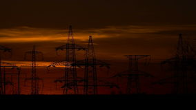 High-voltage power lines at sunrise stock footage