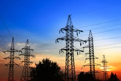 Electric transmission towers. High-voltage power lines at sunset. Electric transmission towers Royalty Free Stock Image