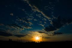 high-voltage power lines at sunset. electricity distribution sta stock image