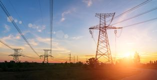 High-voltage power lines at sunset. electricity distribution station.  royalty free stock photography