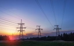 High-voltage power lines at sunset. electricity distribution station.  stock photography