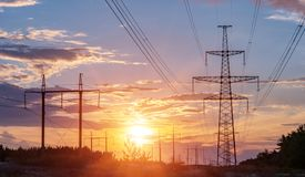 High-voltage power lines at sunset. electricity distribution station. high voltage electric transmission tower. High-voltage power lines at sunset. electricity stock photo