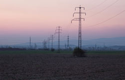High-voltage power lines at sunset Royalty Free Stock Images