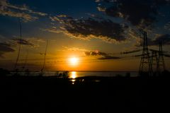 high-voltage power lines at sunset. electricity distribution sta royalty free stock photos