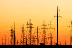 High voltage power lines at sunset royalty free stock photos