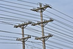 High voltage power lines in urban setting stock photos
