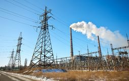 High voltage power lines in the winter. Thermal power plant. Stock Photos