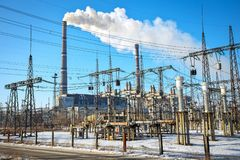 High voltage power lines in the winter. Thermal power plant. Stock Photo