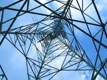 High Voltage Power Mast. Large iron structure set against the sky Royalty Free Stock Photography