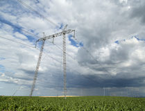High voltage power pilons on agricultural fields Royalty Free Stock Images