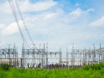 High voltage power plant and transformation station at sunset : Royalty Free Stock Photography