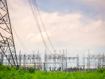 High voltage power plant and transformation station at sunset : Royalty Free Stock Image