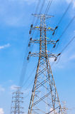High voltage power pole and electricity line with blue sky backg Stock Image