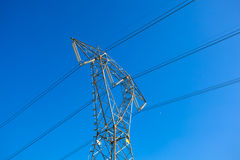 High voltage power pole over the blue clear sky Royalty Free Stock Image