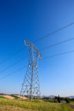 High voltage power pole over the blue clear sky Stock Photos