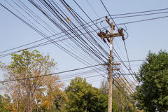 High voltage power pole with wires tangled Royalty Free Stock Photo