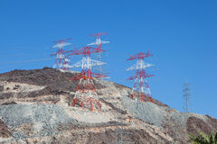 High voltage power poles on top of a mountain Stock Photography
