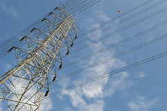 High voltage power and power line with blue sky Royalty Free Stock Image