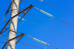 High voltage power pylon against blue sky Royalty Free Stock Photos