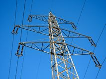 High Voltage Power Pylon and Blue Sky in the Countryside stock photos
