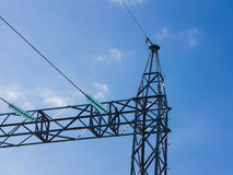 High voltage power pylons against blue sky Stock Image