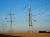 High Voltage Power Pylons and Blue Sky in the Countryside royalty free stock photos