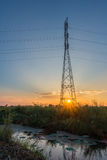 High voltage power pylons in the field Stock Image
