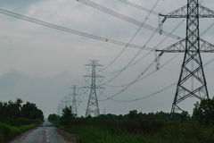 High voltage power pylons and the road Royalty Free Stock Images
