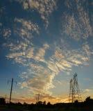 High voltage power pylons in sunset scene twilight Stock Photos