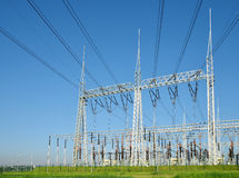 High voltage power substation. High voltage power substation on blue sky background Royalty Free Stock Photos