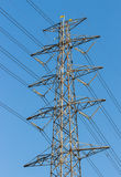 High voltage power tower. On blue sky Stock Photography