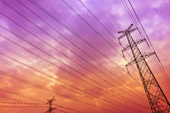 High voltage power tower pylon and line cables Stock Photography