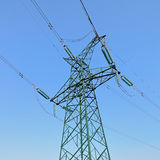 High-voltage power tower under blue sky Stock Image