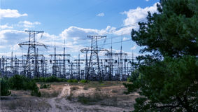 High voltage power transformer substation and pylons. Stock Photography