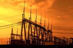 High voltage power transformer substation, sunset. Sky Stock Photography