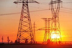 Free High-voltage Power Transmission Line. Energy Pillars. At Sunset, Dawn. High-tension Stock Image - 77272151