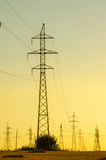 High-voltage power transmission line. Energy pillars. At sunset, Royalty Free Stock Photography