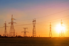 High-voltage power transmission line. Energy pillars. At sunset, Stock Images