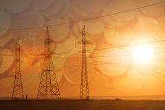 High-voltage power transmission line. Energy pillars. At sunset, Royalty Free Stock Image