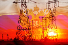 High-voltage power transmission line. Energy pillars. At sunset, Stock Photos