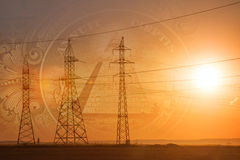 High-voltage power transmission line. Energy pillars. At sunset, Stock Photography