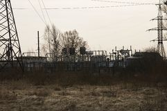 High voltage power transmission line with substation and towers royalty free stock photo