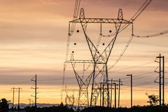 High voltage power lines at sunset stock photography