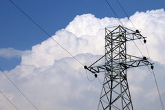 High-voltage power transmission tower. In blue sky background stock photos
