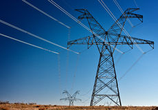 High voltage power transmission towers Royalty Free Stock Images
